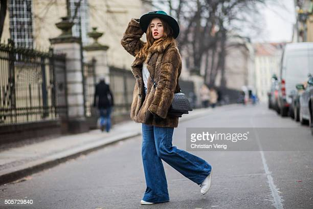 Laura Kokinova wearing a vintage coat Asos pants Filippo Catarzi hat otherstories bag Sweater and shoes Adidas during the MercedesBenz Fashion Week...