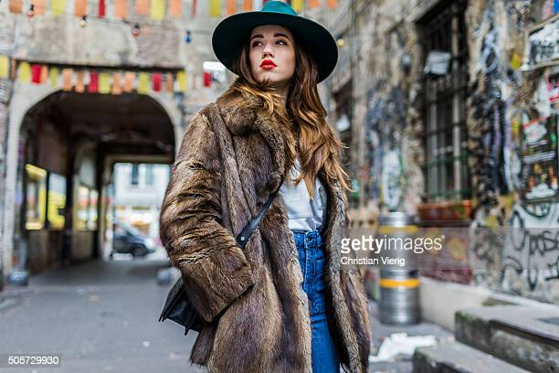 Laura Kokinova wearing a vintage coat Asos pants Filippo Catarzi hat otherstories bag Sweater Adidas during the MercedesBenz Fashion Week Berlin...