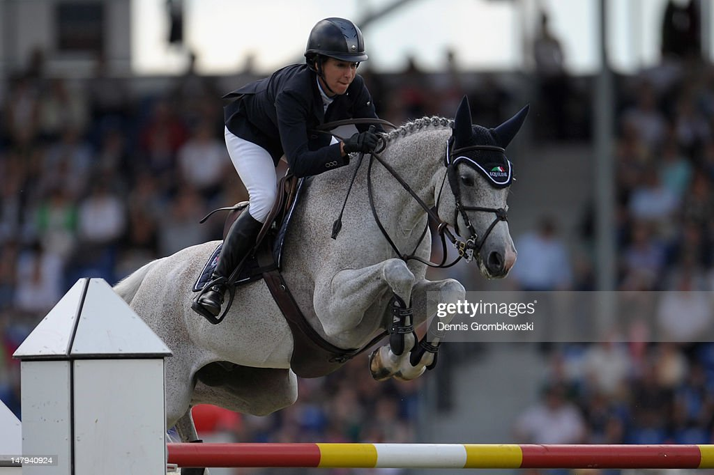 <a gi-track='captionPersonalityLinkClicked' href=/galleries/search?phrase=Laura+Kraut&family=editorial&specificpeople=2245931 ng-click='$event.stopPropagation()'>Laura Kraut</a> of USA and her horse Cedric compete in the RWE Prize of North-Rhine-Westphalia jumping competition during day four of the 2012 CHIO Aachen tournament on July 6, 2012 in Aachen, Germany.