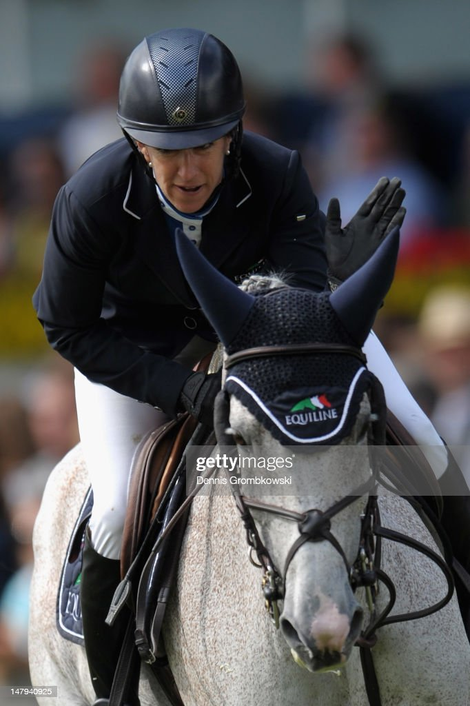 Laura Kraut of USA and her horse Cedric compete in the RWE Prize of North-Rhine-Westphalia jumping competition during day four of the 2012 CHIO Aachen tournament on July 6, 2012 in Aachen, Germany.