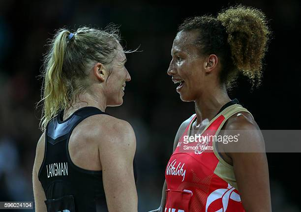 Laura Langman of New Zealand and Serena Guthrie of England share a joke during the International Test Match between New Zealand and England on August...