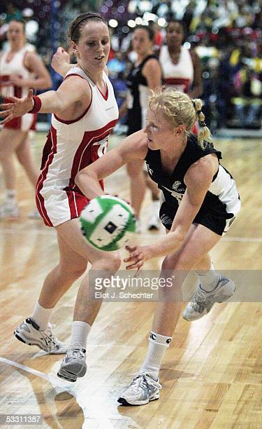 Laura Langman of New Zealand passes around Sara Bayman of England during the Final match at the World Netball Youth Championships on July 31 2005 in...