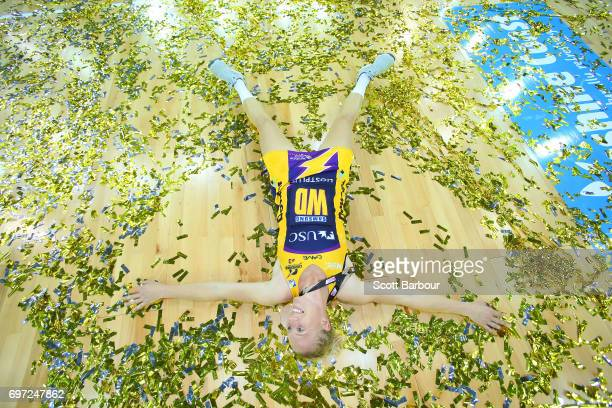 Laura Langman of the Lightning celebrates victory amongst the confetti after winning the Super Netball Grand Final match between the Lightning and...