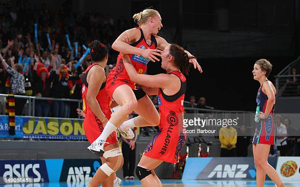 Laura Langman of the Magic leaps in the air at full time as Chelsey Tregear of the Vixens looks on after the ANZ Championship Grand Final match...