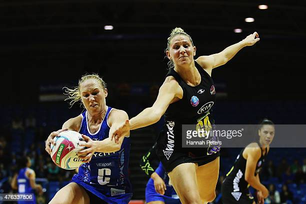 Laura Langman of the Mystics secures the ball as Casey Kopua of the Magic defends during the New Zealand Conference ANZ Championship Final between...