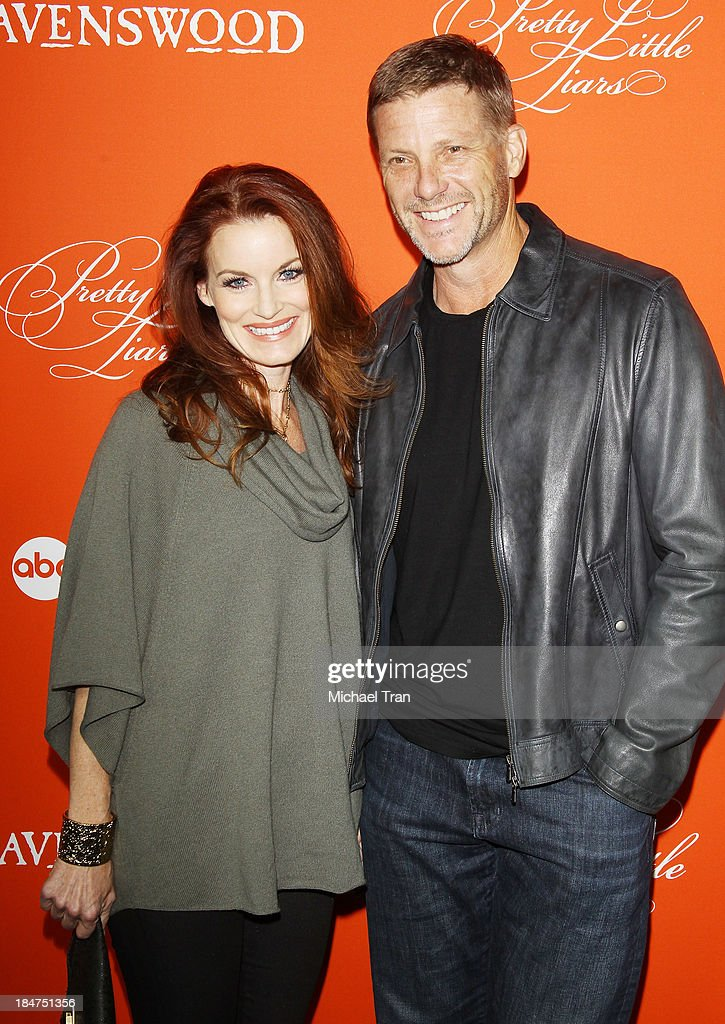 <a gi-track='captionPersonalityLinkClicked' href=/galleries/search?phrase=Laura+Leighton&family=editorial&specificpeople=228022 ng-click='$event.stopPropagation()'>Laura Leighton</a> (L) and <a gi-track='captionPersonalityLinkClicked' href=/galleries/search?phrase=Doug+Savant&family=editorial&specificpeople=693345 ng-click='$event.stopPropagation()'>Doug Savant</a> arrive at the 'Pretty Little Liars' celebrates Halloween episode held at Hollywood Forever on October 15, 2013 in Hollywood, California.