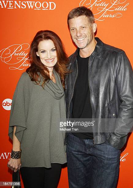 Laura Leighton and Doug Savant arrive at the 'Pretty Little Liars' celebrates Halloween episode held at Hollywood Forever on October 15 2013 in...