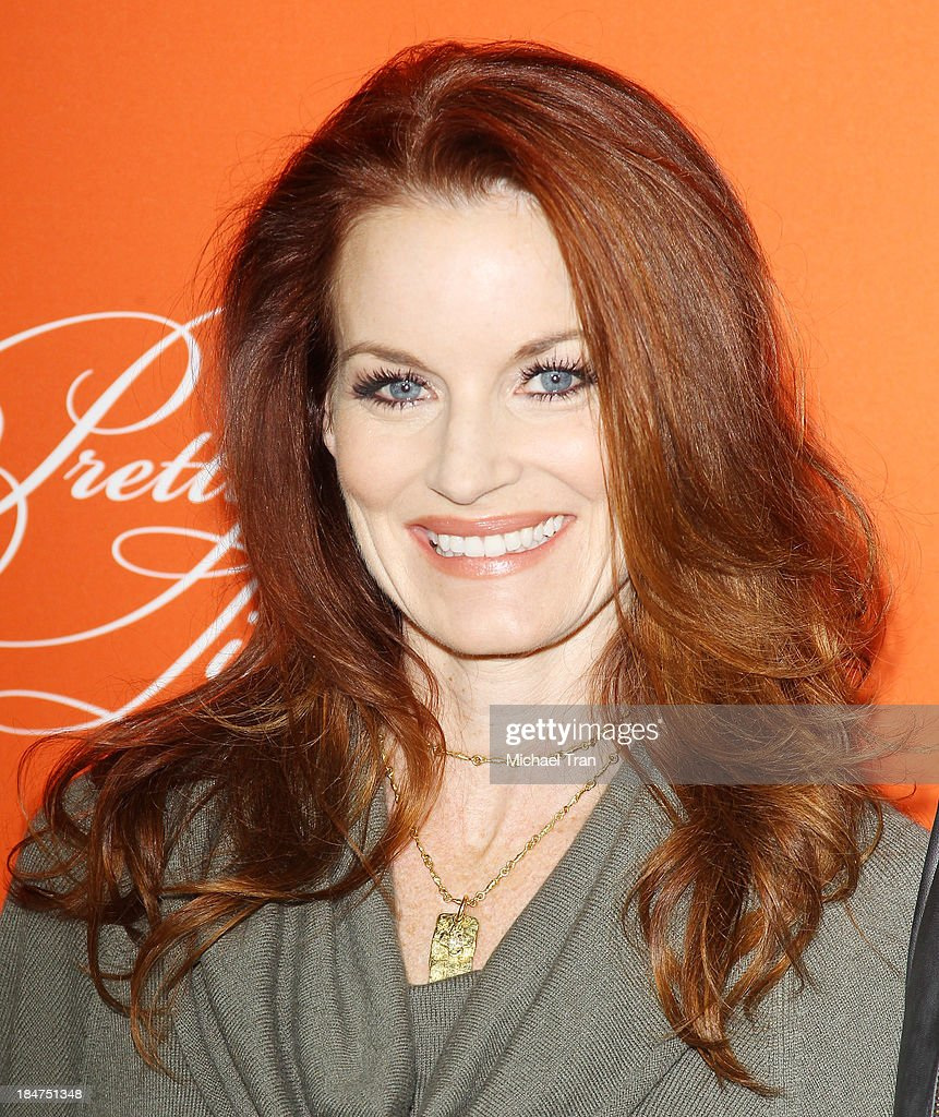 <a gi-track='captionPersonalityLinkClicked' href=/galleries/search?phrase=Laura+Leighton&family=editorial&specificpeople=228022 ng-click='$event.stopPropagation()'>Laura Leighton</a> arrives at the 'Pretty Little Liars' celebrates Halloween episode held at Hollywood Forever on October 15, 2013 in Hollywood, California.