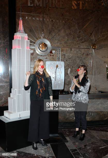 Laura Linney and Lucia Moniz light The Empire State Building in honor of Red Nose Day at The Empire State Building on May 25 2017 in New York City