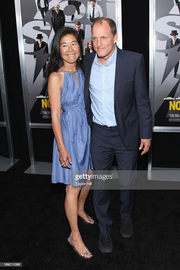 Laura Louie and husband actor Woody Harrelson attend the 'Now You See Me' premiere at AMC Lincoln Square Theater on May 21, 2013 in New York City.