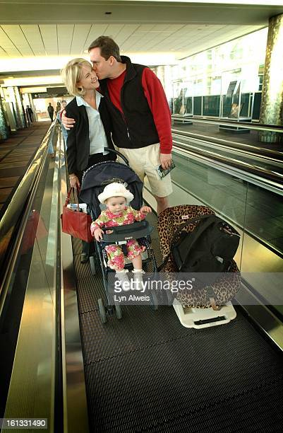 Laura Love and her husband Cole Kimball and their daughter Kirby all head for their flights at DIA Laura with brief case in hand is on a busines trip...