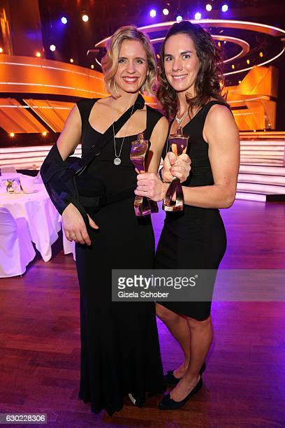 Laura Ludwig and her beach volleyball team mate Kira Walkenhorst Olympic gold medalist champion with award during the 'Sportler des Jahres 2016' Gala...