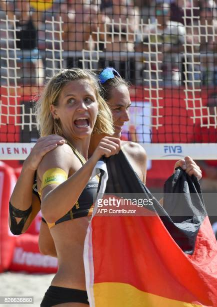 Laura Ludwig and Kira Walkenhorst of Germany celebrate after the gold medal match against United States at the Beach Volleyball World Championship in...