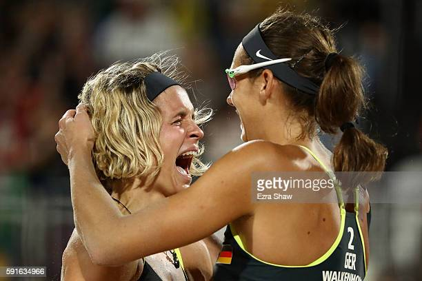 Laura Ludwig and Kira Walkenhorst of Germany celebrate winning match point during the Beach Volleyball Women's Gold medal match against Agatha...