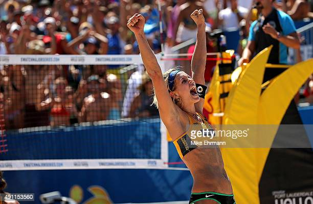 Laura Ludwig of Germany celebrates winning a match against Agatha Bednarczuk and Barbara Seixas of Brazil at the FIVB Fort Lauderdale Swatch Season...