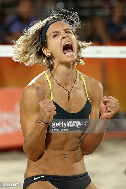 Laura Ludwig of Germany celebrates winning match point during the Beach Volleyball Women's Gold medal match against Agatha Bednarczuk Rippel of...