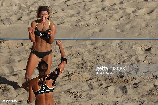 Laura Ludwig of Germany celebrates with teammates Kira Walkenhorst after defeating Switzerland during a Women's Round of 16 match on Day 8 of the Rio...