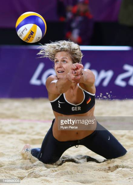 Laura Ludwig of Germany dives for the ball during the Women's Beach Volleyball Quarter Final match between Brazil and Germany on Day 9 of the London...