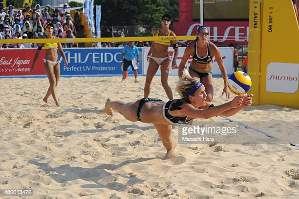 Laura Ludwig of Germany receives the ball during their main draw match against Agatha Bednarczuk and Barbara Seixas De Freitas of Brazil on July 26...