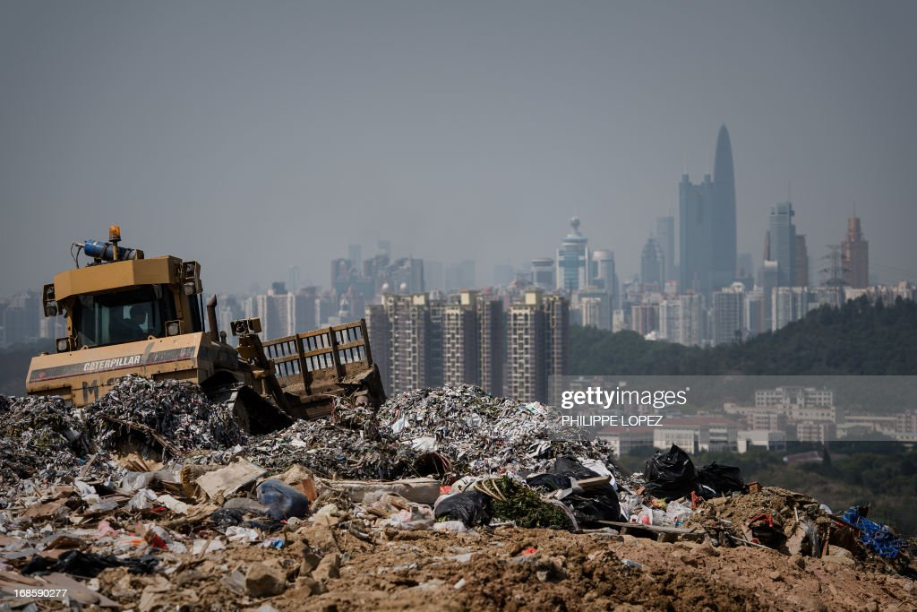 Laura Mannering This picture taken on March 6 2013 shows a landfill in the new territories of Hong Kong as the Chinese city of Shenzhen looms in the...