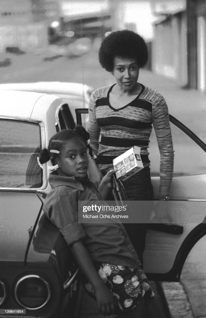 Laura Marie and her mother Cynthia Robinson of the psychedelic soul group 'Sly And The Family Stone' stand next to a car on April 3, 1973 in San Francisco, California.