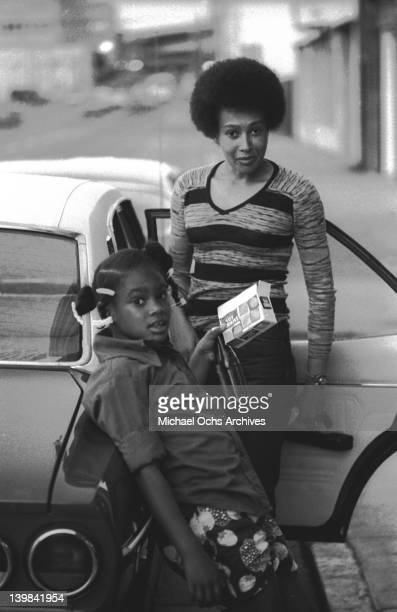 Laura Marie and her mother Cynthia Robinson of the psychedelic soul group 'Sly And The Family Stone' stand next to a car on April 3 1973 in San...
