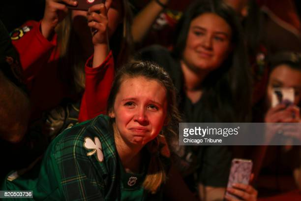 Laura Marie Polzin of Aurora Ill gets emotional while watching replays from last season during the 2017 Blackhawks Convention at the Hilton Downtown...