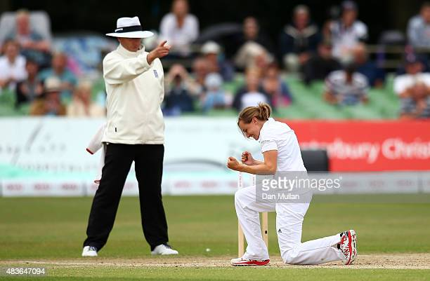 Laura Marsh of England celebrates as Umpire Neil Mallender signals the wicket of Megan Schutt of Australia during day one of the Kia Women's Test of...