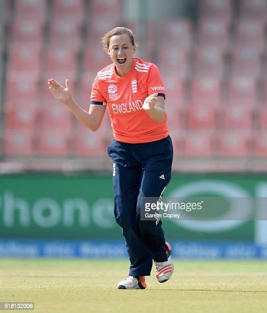 Laura Marsh of England celebrates dismissing Alyssa Healy of Australia during the Women's ICC World Twenty20 India 2016 Semi Final between England...