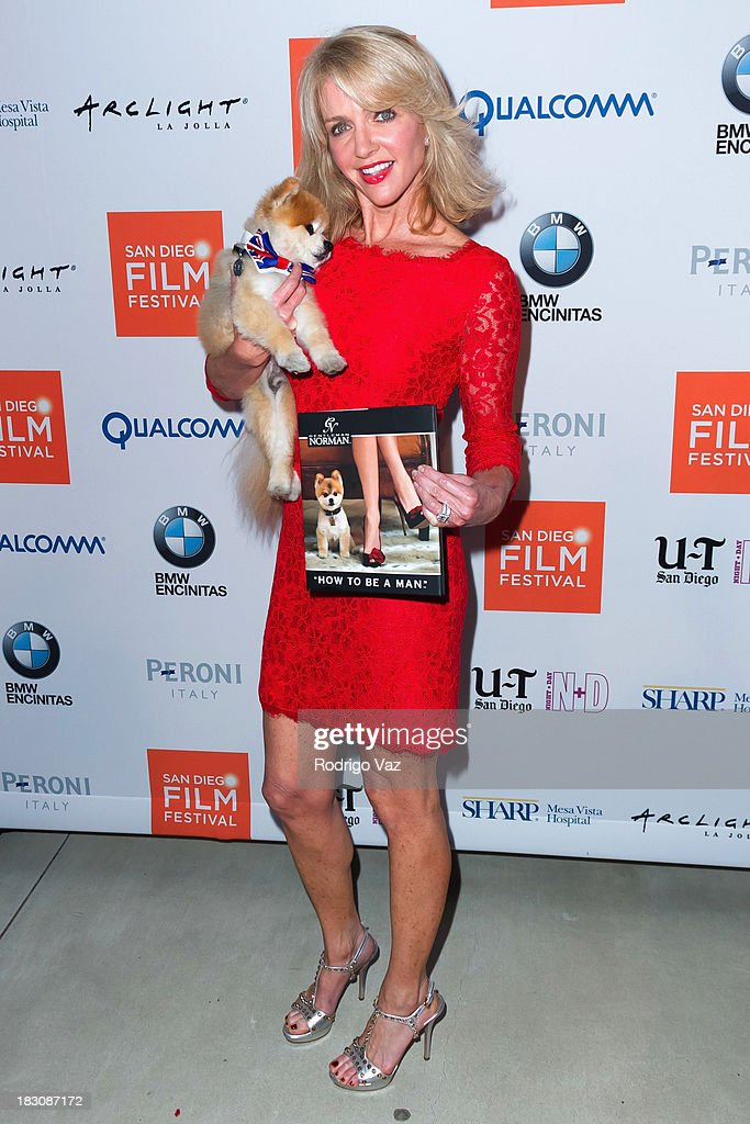 Laura Martella and Gentleman Norman arrive at San Diego Film Festival's tribute to honor <a gi-track='captionPersonalityLinkClicked' href=/galleries/search?phrase=Judd+Apatow&family=editorial&specificpeople=854225 ng-click='$event.stopPropagation()'>Judd Apatow</a> at Museum of Contemporary Art on October 3, 2013 in La Jolla, California.