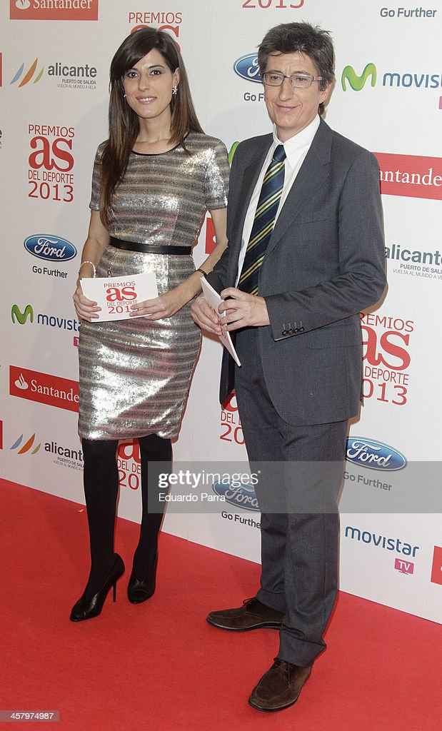 Laura Martinez and Juan Carlos Rivero attends 'As del deporte' awards 2013 photocall at Palace hotel on December 19, 2013 in Madrid, Spain.