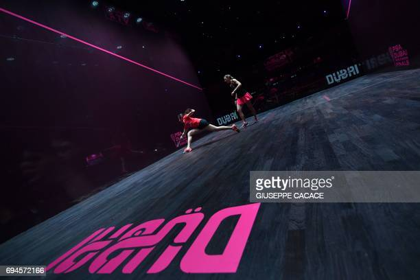 Laura Massaro of England competes against Nour El Sherbini of Egypt during the finals of the PSA Dubai World Series Finals 2017 at Dubai Opera on...