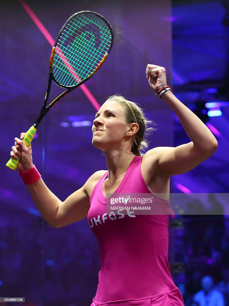 Laura Massaro of Great Britian jubilates after beating Raneem el-Welily of Egypt in the final match of the Dubai PSA World Series Finals squash tournament in Dubai, May 28, 2016. / AFP / MARWAN