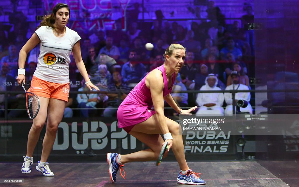 Laura Massaro (R) of Great Britian plays a backhand to Nour El Sherbini of Egypt during their semi-final match of the Dubai PSA World Series Finals squash tournament in Dubai on May 27, 2016. / AFP / MARWAN