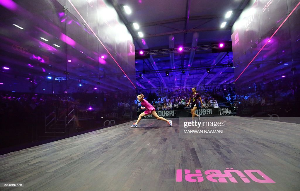 Laura Massaro (L) of Great Britian plays a forehand to Raneem el-Welily of Egypt in the final match of the Dubai PSA World Series Finals squash tournament in Dubai, May 28, 2016. / AFP / MARWAN