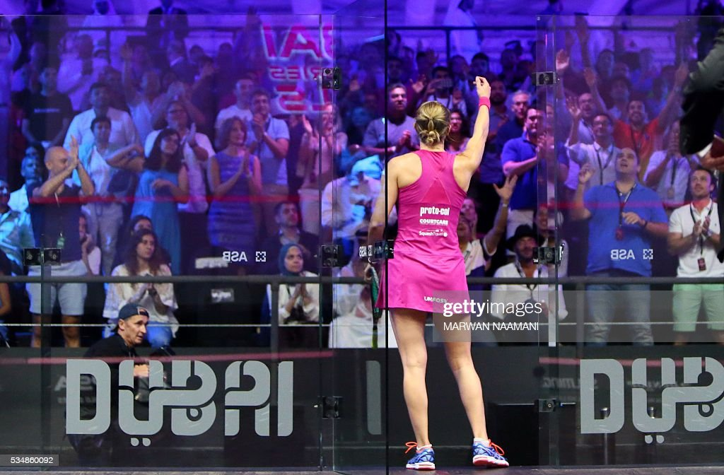 Laura Massaro of Great Britian salutes the crowds after beating Raneem el-Welily of Egypt in the final match of the Dubai PSA World Series Finals squash tournament in Dubai, May 28, 2016. / AFP / MARWAN