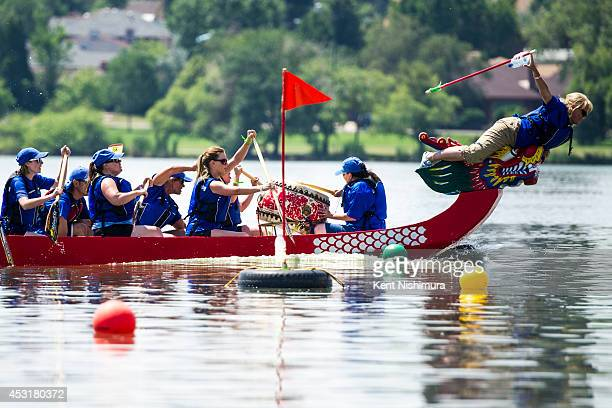 Laura McFadden flag puller for Team Security Service One pulls the flag in a race with Team Seas The Dragon during the 2014 Colorado Dragon Boat...