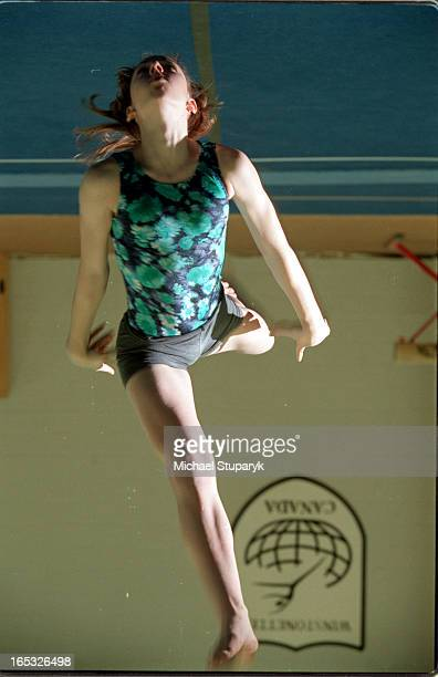 Laura McLaren of the Winstonette Gymnastics Clubhas a full scholarship to Central Michigan University on beamchalking hands and doing some floor...