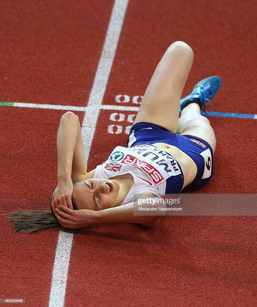 Laura Muir of Great Britain Northern Ireland lies on the track after coming fourth in the Women's 3000 metres Final during day two of the 2015...