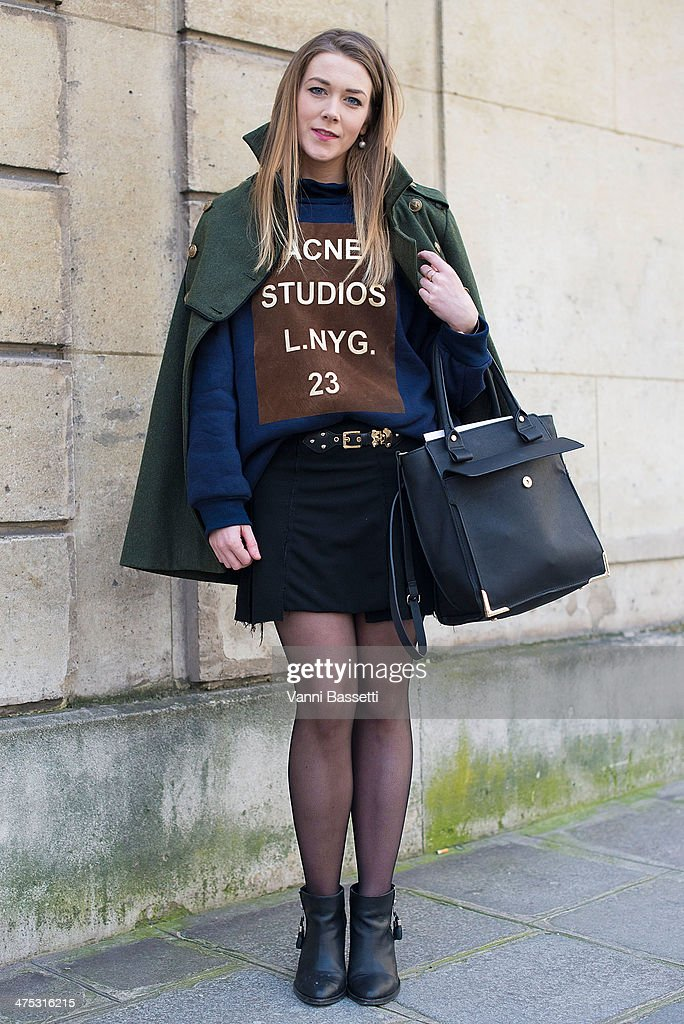 Laura Murphy wears Urban Outfitters shoes and coat, Zara skirt and bag and ACNE Studios sweater before Alexis Mabille show on February 26, 2014 in Paris, France.
