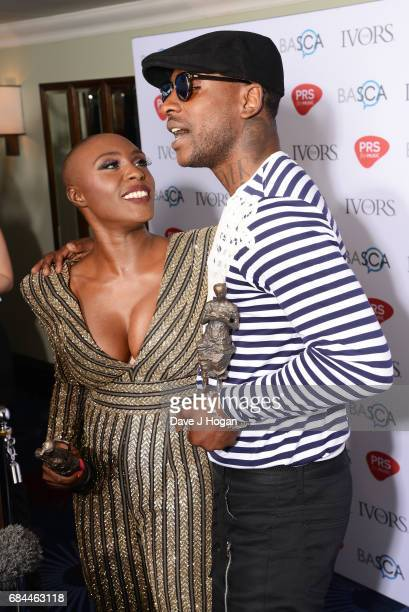 Laura Mvula and Skepta pose in the winners room with the Album Award and the Songwriter of the Year award at the Ivor Novello Awards at Grosvenor...