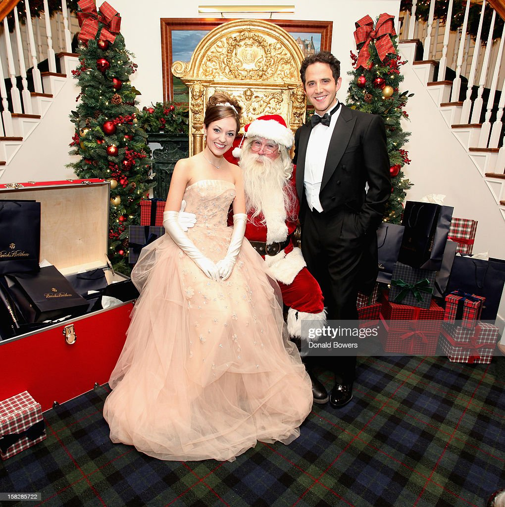 Laura Osnes and Santino Fontana, Cinderella and Prince from Rodgers and Hammerstein's Cinderella, pose with Santa Claus during The Brooks Brothers Hosts Seventh Annual Holiday Celebration To Benefit St Jude Children's Research Hospital on December 12, 2012 in New York City.
