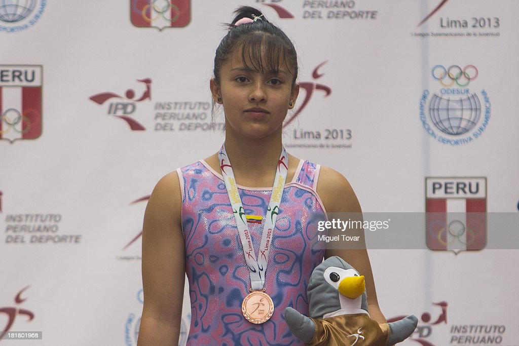 Laura Pardo of Colombia poses with her bronze medal as part of the I ODESUR South American Youth Games at Coliseo Miguel Grau on September 25, 2013 in Lima, Peru.