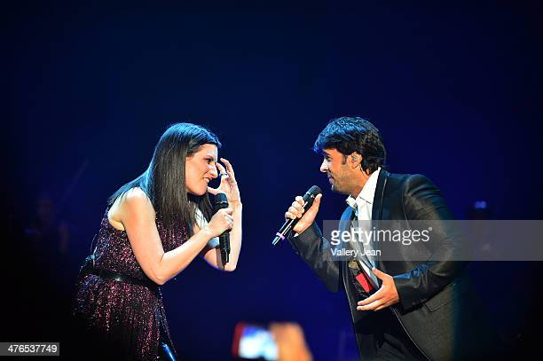 Laura Pausini and Luis Fonsi perform at James L Knight Center on March 2 2014 in Miami Florida