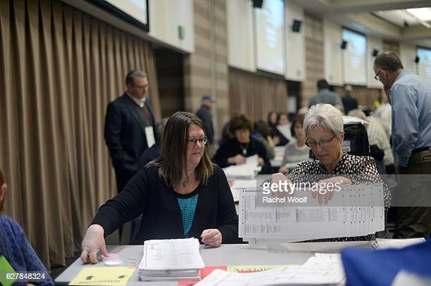 Laura Pierce Deputy Clerk of Auburn Hills and Sue Camilleri City Clerk of Waterford Township recount presidential ballots at the Oakland Schools...