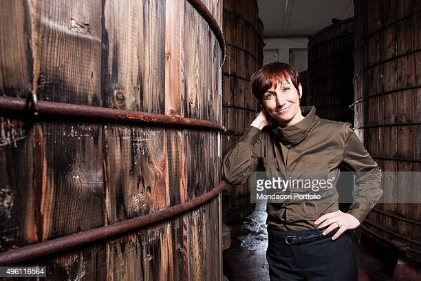 Laura Ponti cousin of the general manager of the Italian vinegar company of the same name Giacomo Ponti posing for a photo shooting among the barrels...
