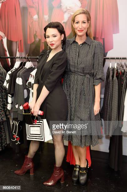 Laura Pradelska and a Lulu Guinness model attend the Lulu x Vaseline launch party at Lulu Guinness at Covent Garden on October 12 2017 in London...