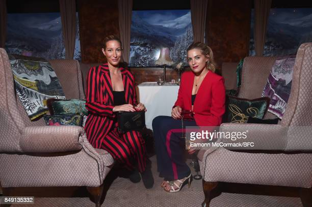 Laura Pradelska and Olivia Cox attend the Aspinal of London presentation during London Fashion Week September 2017 on September 18 2017 in London...