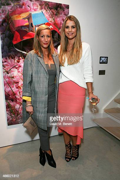 Laura Pradelska and Vogue Williams attend a private view of Miniaturesque by Slinkachu at Andipa Gallery on March 12 2015 in London England