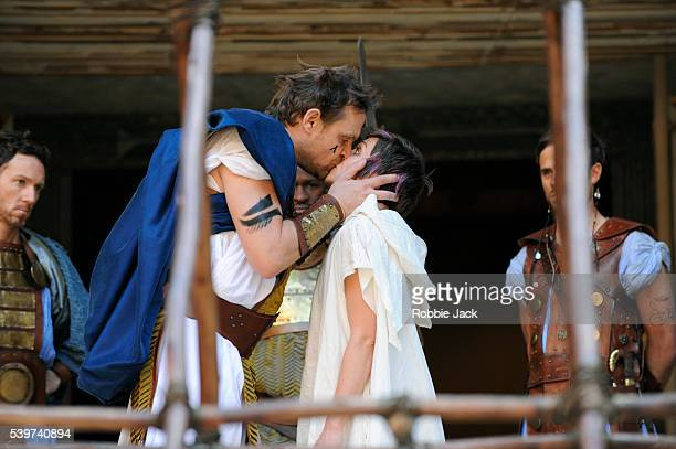 Laura Pyper as Cressida and Mathew Flynn as Agamemnon with artists of the company in the production of William Shakespeare's play'Troilus and...
